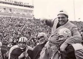Image of Vince Lombardi being hoisted by Green Bay Packers